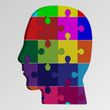 A person`s face consists of a multi-colored puzzle. Vector illustration of a logical task Royalty Free Stock Photo