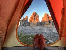 A person`s feet in a tent in the canyon stock image