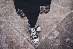 Person's Feet Wearing Black-and-white High-top Sneakers Stock Photo