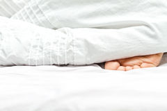 Person's foot in bed Stock Photos