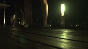 A person`s foot on wood. A medium shot of person`s foot on wood stock footage