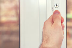The person`s hand closes the window close-up. royalty free stock photo