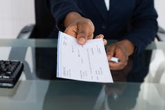 Person's Hand Giving Cheque Royalty Free Stock Image