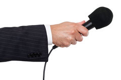 Person's hand holding a microphone. Isolated stock photos