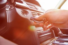 Person's Hand Inserting Key To Start Car Royalty Free Stock Photography