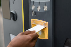 Person`s Hand Inserting Ticket Into Parking Machine Stock Photos