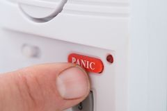 Person's hand pressing panic button Royalty Free Stock Image