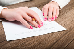 Person's hand signing an important document Royalty Free Stock Images