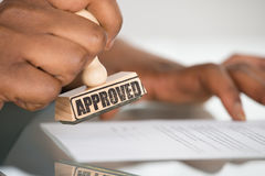 Person's Hand Stamping On Contract Form Stock Images