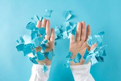 Person`s hands throwing paper pieces. Person`s hands throwing crumpled paper pieces into the air stock images