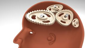 Human head profile with a set of loose and broken cogwheels that symbolize illogical thinking. A person`s profile with twisted and misaligned wooden cogwheels Royalty Free Stock Photo