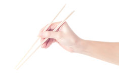 Person `s right hand using bamboo chopsticks Royalty Free Stock Photography