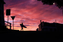 Person's Walking Holding Surf Board during Sunset Stock Photography
