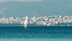 Person sailboarding offshore Stock Photo