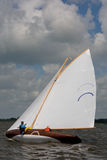 Person sailing yacht  Stock Images
