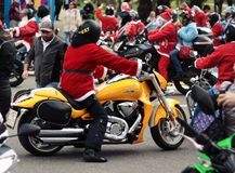 Person in Santa Suit Riding Yellow Cruiser Motorcycle royalty free stock images
