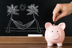 Person Saving Money In Piggybank For Vacation Stock Images