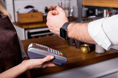 Person scanning smartwatch for payment Royalty Free Stock Photography