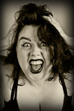 The person screaming woman. Middle-aged woman in a bra screaming his head in his hands, a look of horror and fear, sepia, close-up Stock Photos