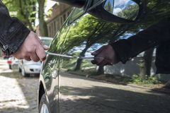 A person is scratching a car Royalty Free Stock Photo