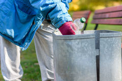Person scrounging through a bin Royalty Free Stock Photos