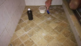 Person Scrubbing Shower Tile Floor stock video
