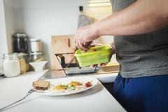 A person preparing a healthy breakfast Stock Images