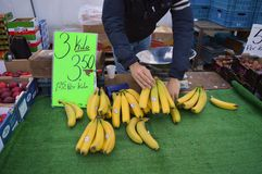 person selling bananas on a market Royalty Free Stock Photos