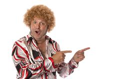 Groovy Dude Pointing. A person in seventies get up points to one side. Add own text Stock Photography