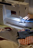 Person on sewing machine making bunting Royalty Free Stock Photo