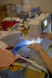 Person on sewing machine making bunting Royalty Free Stock Photography