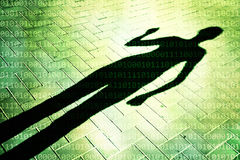 Person shadow with binary numbers background. Female person shadow stand down the street with added conceptual binary numbers. Conceptual spy and anonymous Stock Image