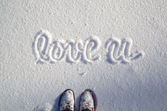 Person shoes with love you winter season Royalty Free Stock Photo
