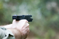 Person shooting pistol or gun Stock Image
