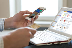Person shopping making Mobile Payment with Telephone Royalty Free Stock Photos