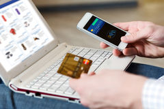 Person shopping making Mobile Payment with Telephone Royalty Free Stock Images
