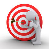 Person showing an arrow in the center of target. 3d person satisfied is showing an arrow in the center of a red and white target Stock Photography