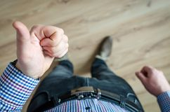 Person Showing His Left Thumb Royalty Free Stock Photo