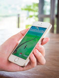 Person showing Pokemon Go game application. CHIANGRAI, THAILAND - August 17, 2016: Person holding mobile phone and showing Pokemon Go game application. Pokemon royalty free stock images