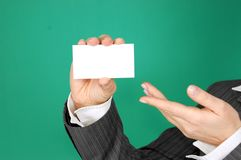 Person Showing White Piece of Paper Stock Photos