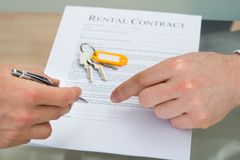 Person signing rental contract Stock Image