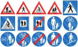 Person Signs in Austria. Collection of Austrian traffic signs containing persons like road workers, pedestrians, cyclists and children Royalty Free Stock Image