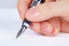 Person signs documents - hand close up Stock Images