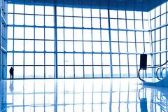 Person silhouette in glass corner. Of office centre Royalty Free Stock Photo