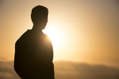 Person silhouette. In morning sunrise Stock Photo