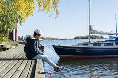 Person Sitting On Dock royalty free stock photography