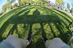 Person sitting on park bench fisheye Royalty Free Stock Photography