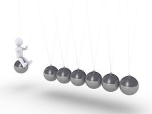 Person sitting on sphere of Newton's cradle Stock Image