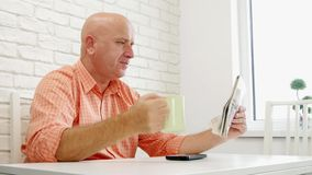 Person Sitting on the Table Relaxed read Newspaper and Drink a Cup with Coffee.  stock video