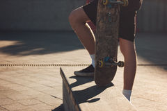 Person with skateboard outdoors. Stock Photo